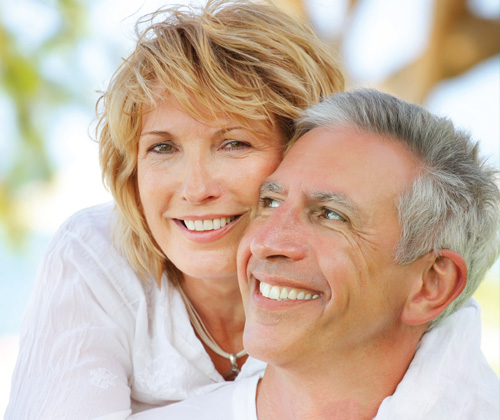 Middle age couple smiling - The Continence Foundation of Ireland (CFI) is a multidisciplinary group of 10 independent gynaecologists and urologists in Ireland with an interest in all aspects of urinary and faecal incontinence